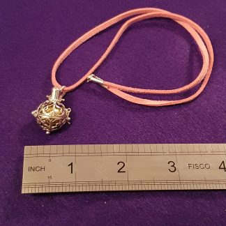 silver angel bell on pink suede strap