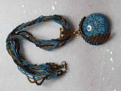 Beaded choker necklace in blue and gold