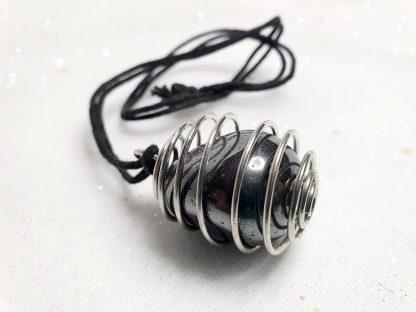 Hematite spiral cage necklace