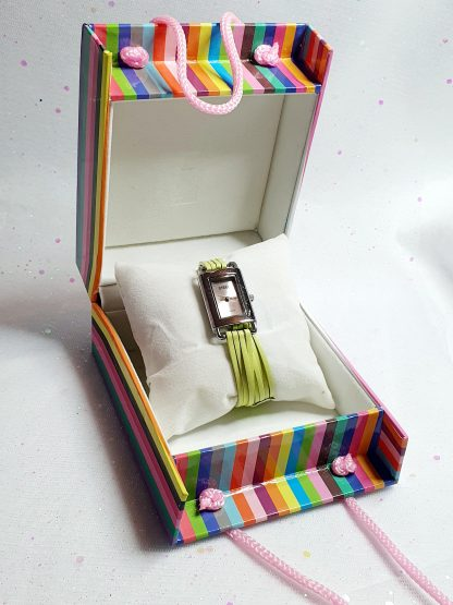 Watch in a stripy presentation box.