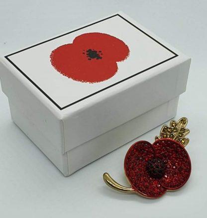 Dereks Poppy with box